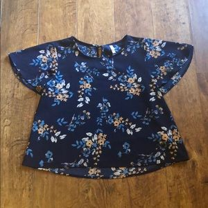 blue blouse with multi-color flowers
